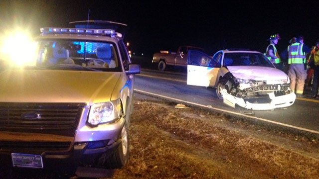 A police sport utility vehicle and a white car are both damaged after a crash near Honea Path. (Feb. 11, 2013/FOX Carolina)