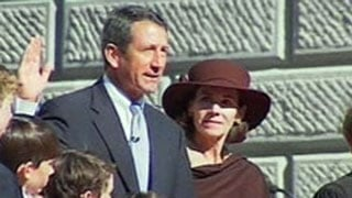 Mark Sanford is sworn in for his second gubernatorial term as his ex-wife, Jenny, watches alongside. (File/FOX Carolina)