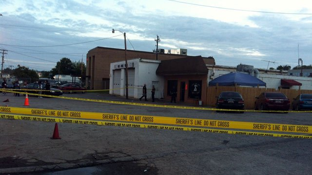 """Crime scene tape surrounds the parking lot of """"Bobby T's"""" after a fatal shooting. (Aug. 6, 2012/FOX Carolina)"""