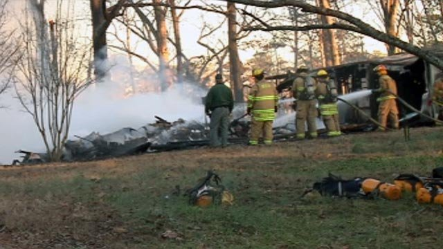 Firefighters extinguish the blaze in one of the Fair Play homes that was destroyed by fire. (Feb. 17, 2013/FOX Carolina)