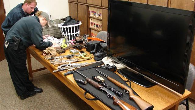 Deputies catalog the items stolen during the burglaries. (Union Co. Sheriff's Office)