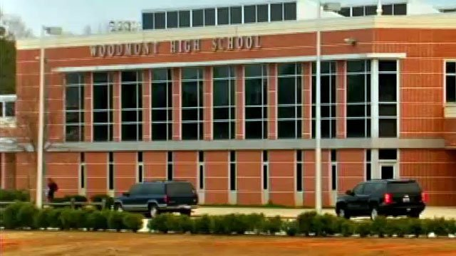 Two vehicles are parked in front of Woodmont High School in Greenville County. (File/FOX Carolina)