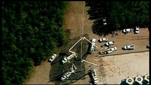 Investigators comb the scene of a fatal plane crash in eastern Georgia. (WSMV-TV/Feb. 21, 2013)