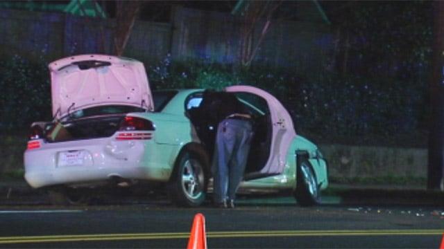 Investigators search the car they said was abandoned by the trio. (Feb. 21, 2013/FOX Carolina)