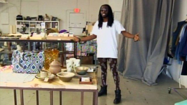 Delvin Choice tries on a pair of camouflage meggings. (Feb. 21, 2013/FOX Carolina)