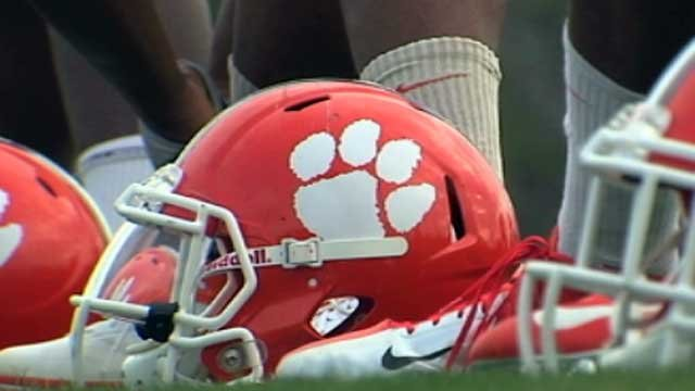 A Clemson football helmet is displayed on a practice field. (File/FOX Carolina)