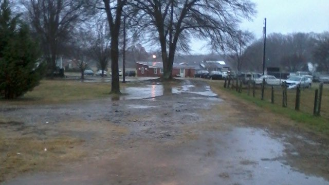 A Gray Court lawn covered in rain puddles. (Feb. 26, 2013/FOX Carolina iWitness S. Johns)