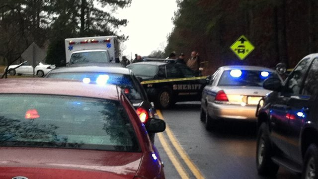 Deputies, troopers and investigators have blocked off Sharon Church Road where the body was found. (Feb. 26, 2013/FOX Carolina)