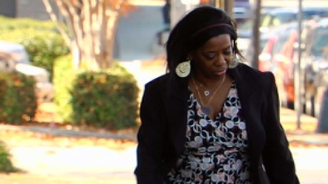 Shirley Rogers looks away from the cameras as she walks into the federal courthouse in Greenville with her lawyer. (Nov. 29, 2012/FOX Carolina)
