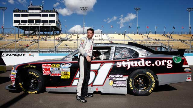 Driver Jeremy Clements stands next to his car after qualifying for the NASCAR Nationwide Series auto race Saturday, Nov. 10, 2012, at Phoenix International Raceway in Avondale, Ariz.(AP Photo/Paul Connors)