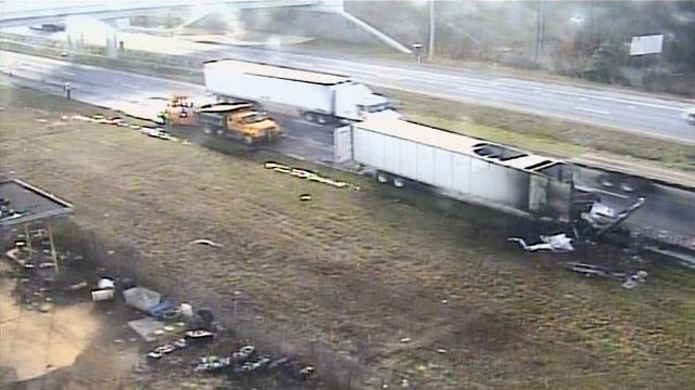 The burned out tractor trailer is moved to the side of southbound I-85 near MM 93. (Feb. 28, 2013/FOX Carolina)