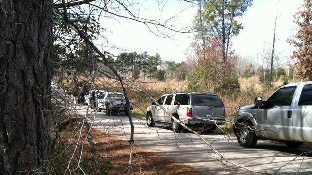 Investigators near the scene of where a body was found in Prosperity Sunday morning. (Mar. 3, 2013/FOX Carolina)
