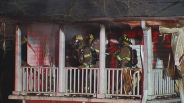 Firefighters extinguish a blaze in a building on Pine Street in Greenville. (Mar. 4, 2013/FOX Carolina)