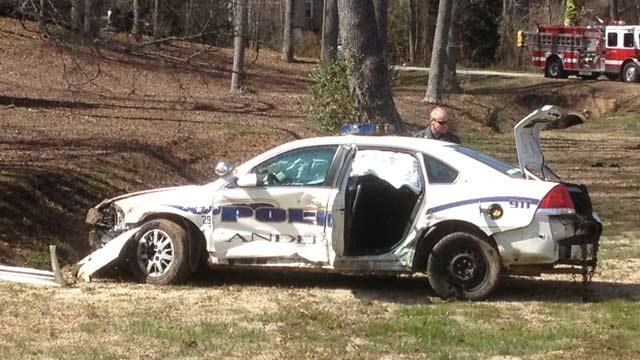 The Anderson police officer's car crashed along E. River Street on Wednesday. (Mar. 6, 2013/FOX Carolina)