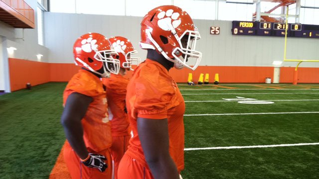Players watch as others practice during Clemson's first spring practice in the new indoor facility. (March 6, 2013/FOX Carolina)