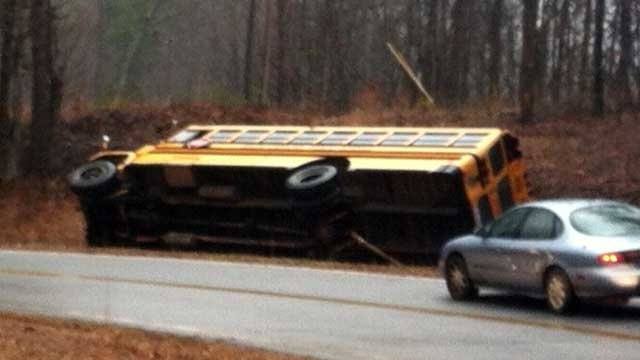 A school bus lays on its side after a crash in Oconee County. (March 11, 2013/FOX Carolina)
