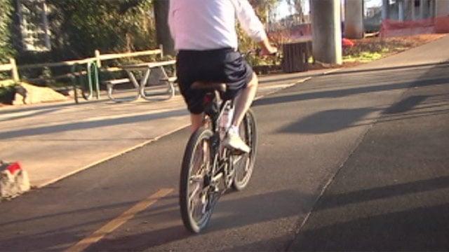 An Upstate cyclist rides his bike along the Swamp Rabbit Trail in downtown Greenville. (Mar. 12, 2013/FOX Carolina)