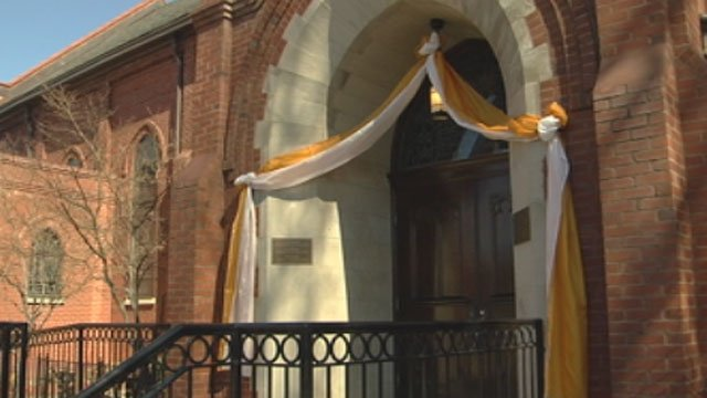 Yellow-and-white bunting is hung from the doors of St. Mary's Catholic Church in Greenville after the election of Pope Francis. (March 13, 2013/FOX Carolina)