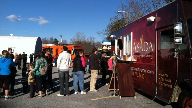 Diners and supporters line up to eat at some local food trucks outside of The Owl on Wednesday. (Mar. 13, 2013/FOX Carolina)