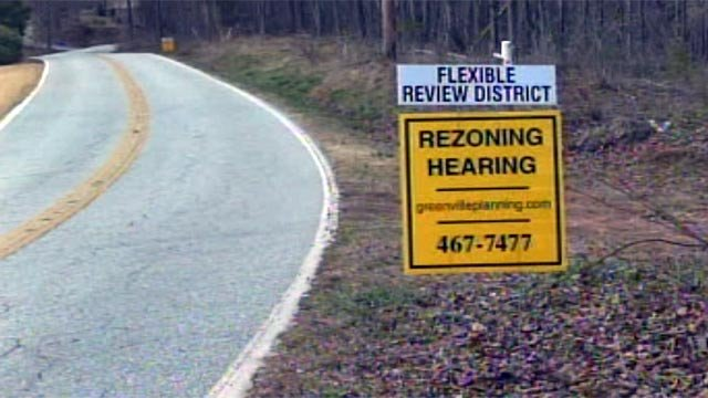 Signs along Altamont Road on Paris Mountain notify residents of rezoning plans. (Mar. 14, 2013/FOX Carolina)
