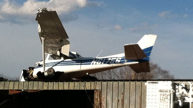 The front and wings of a small airplane are crumpled after a crash at the Hendersonville Airport. (March 15, 2013/FOX Carolina)