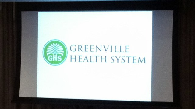 The new logo for Greenville Health System is unveiled at Tuesday's board meeting. (Dec. 18, 2012/FOX Carolina)