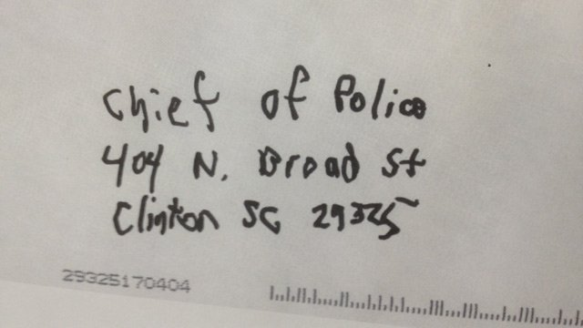 A handwritten envelope sent to police that they say contained a threatening letter. (Mar. 19, 2013/FOX Carolina)