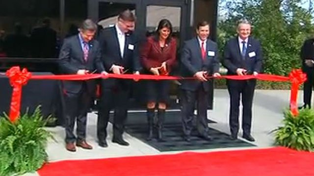South Carolina Gov. Nikki Haley (center) cuts the ribbon to open a new Bosch Rexroth facility in Fountain Inn. (March 20, 2013/FOX Carolina)
