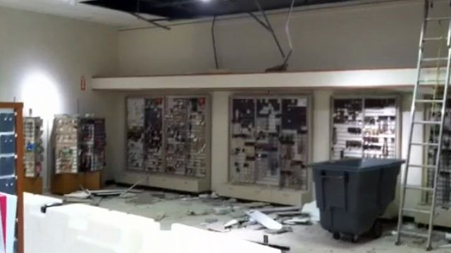 Pieces of ceiling tiles lay on floor of a JC Penny store at Westgate Mall after a collapse. (March 22, 2013/FOX Carolina)