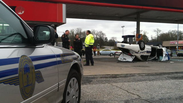The flipped Anderson police car crash in front of the gas station on E. River Street. (Mar. 24, 2013/FOX Carolina)