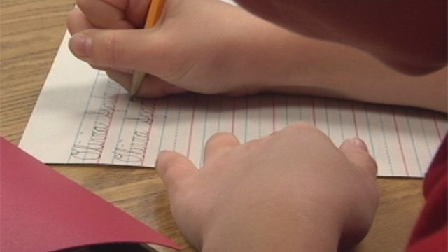An Upstate student practices her cursive writing. (File/FOX Carolina)
