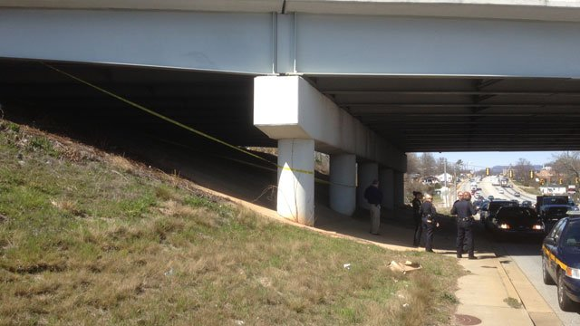 Deputies investigate the discovery of a body under U.S. 123 at White Horse Road. (Mar. 27, 2013/FOX Carolina)