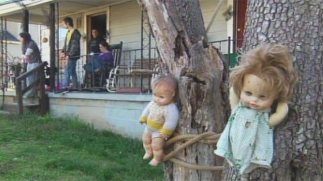 Some of the dolls tied to trees in the McHale family's front yard. (Mar. 27, 2013/FOX Carolina)