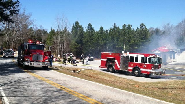 Firefighters work to extinguish a fire at Ekom Fire Dept. in Laurens Co. (Mar. 28, 2013/FOX Carolina)