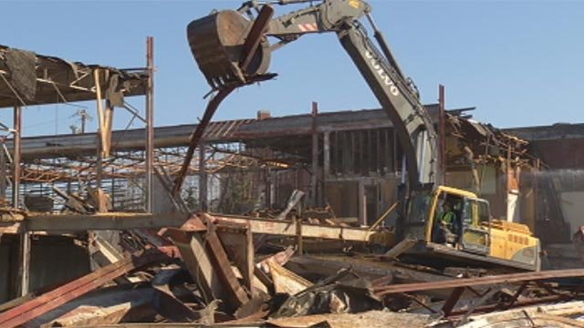 Demolition crews tear down the old Piedmont Shirt Factory along Poinsett Highway. (April 2, 2013/FOX Carolina)