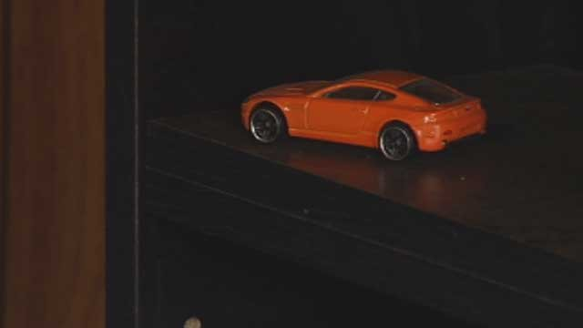 A single toy car remains on a shelf at a home where thieves stole hundreds of Hot Wheels. (April 3, 2013/FOX Carolina)