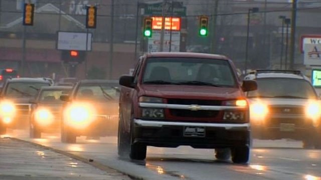 Traffic moves along a wet Woodruff Road in Greenville. (File/FOX Carolina)