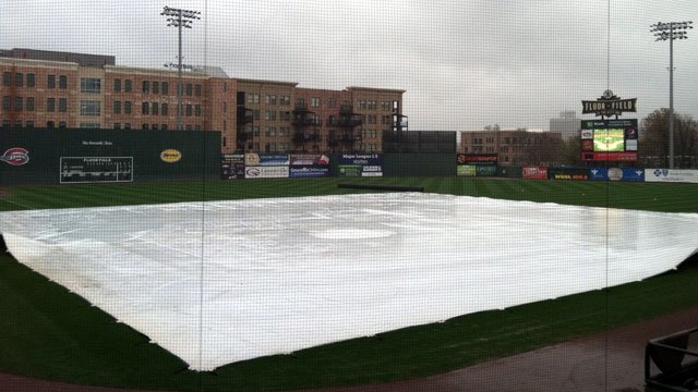 A tarp covers the infield at Fluor Field. (April 4, 2013/FOX Carolina)