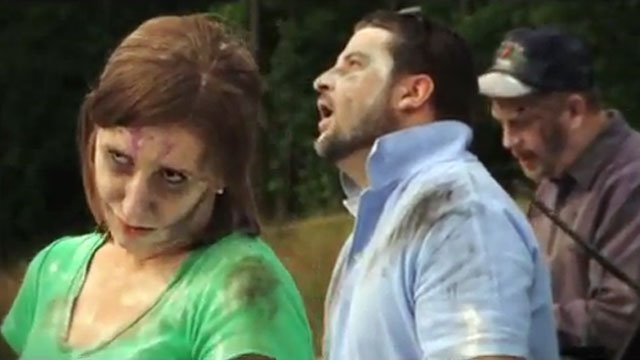 "Three ""zombies"" appear along the side of a road in a distracted driving video produced by the North Carolina Department of Transportation. (Source: YouTube)"