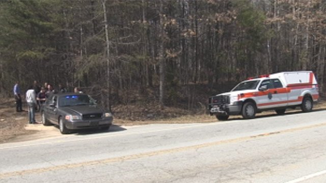 Deputies and paramedics respond to where Hedger and his son were stopped by passersby. (Apr. 6, 2013/FOX Carolina)