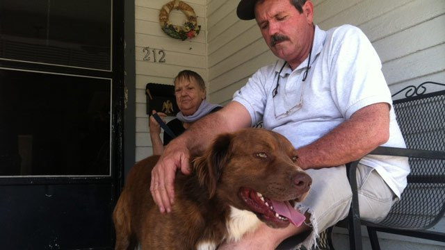 Cocoa with Dennis Keisler and his mother at their Union home where police say the attack happened. (Apr. 10, 2013/FOX Carolina)