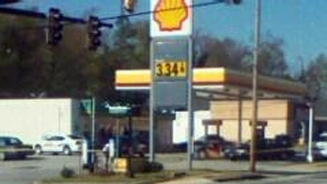 An iWitness photo of police at the Shell station where they say the robbery happened. (Apr. 12, 2013/FOX Carolina iWitness)