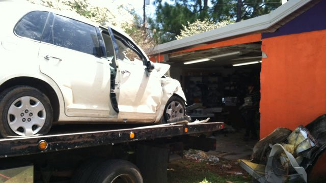 Troopers say the driver of this car died after crashing into Tiger Pawn Shop on Clemson Blvd. Friday. (Apr. 12, 2013/FOX Carolina)