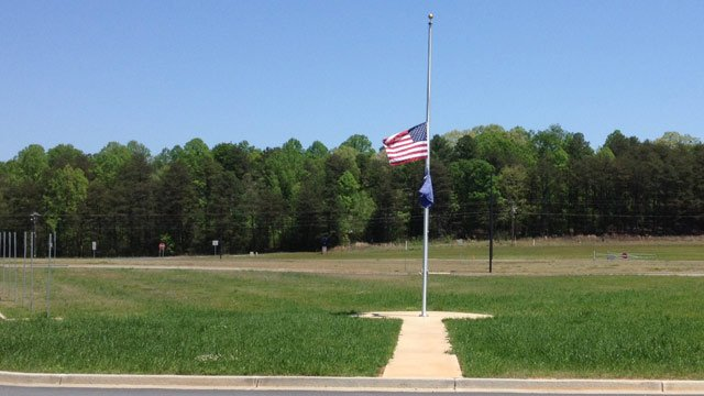Flags fly at half-staff outside of Pickens High School on Monday. (Apr. 22, 2013/FOX Carolina)