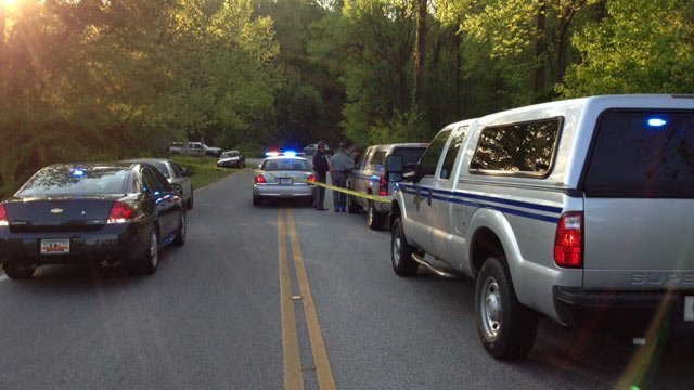 Troopers investigate a fatal hit-and-run wreck along Lake Forest Drive in Spartanburg County Monday morning. (Apr. 22, 2013/FOX Carolina)