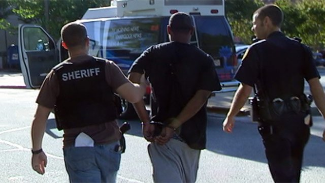 Deputies walk Gregory Miller back to the LEC after chasing after him. (Apr. 25, 2013/FOX Carolina)
