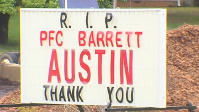 Supporters and business owners, including Davis Grading, honored Austin on Monday upon his body's arrival. (Apr. 29, 2013/FOX Carolina)