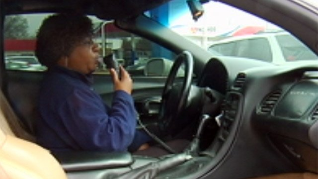FOX Carolina reporter Jennifer Phillips tests an in-car breathalyzer. (File/FOX Carolina)