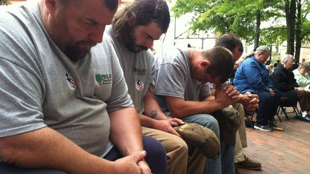 People pray at on National Day of Prayer event in Anderson. (May 2, 2013/FOX Carolina)