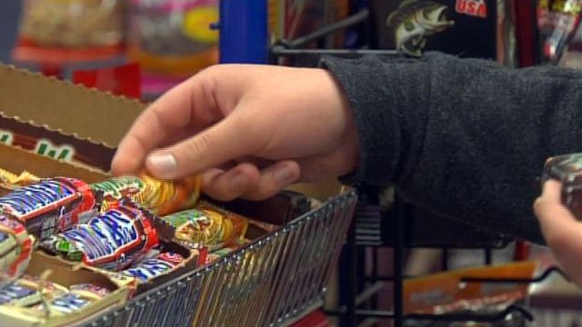 A shopper picks out a candy bar at an Upstate store. (File/FOX Carolina)